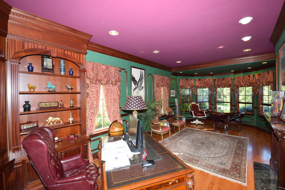 Library with custom cherry cabinets with shelves, molding and trim