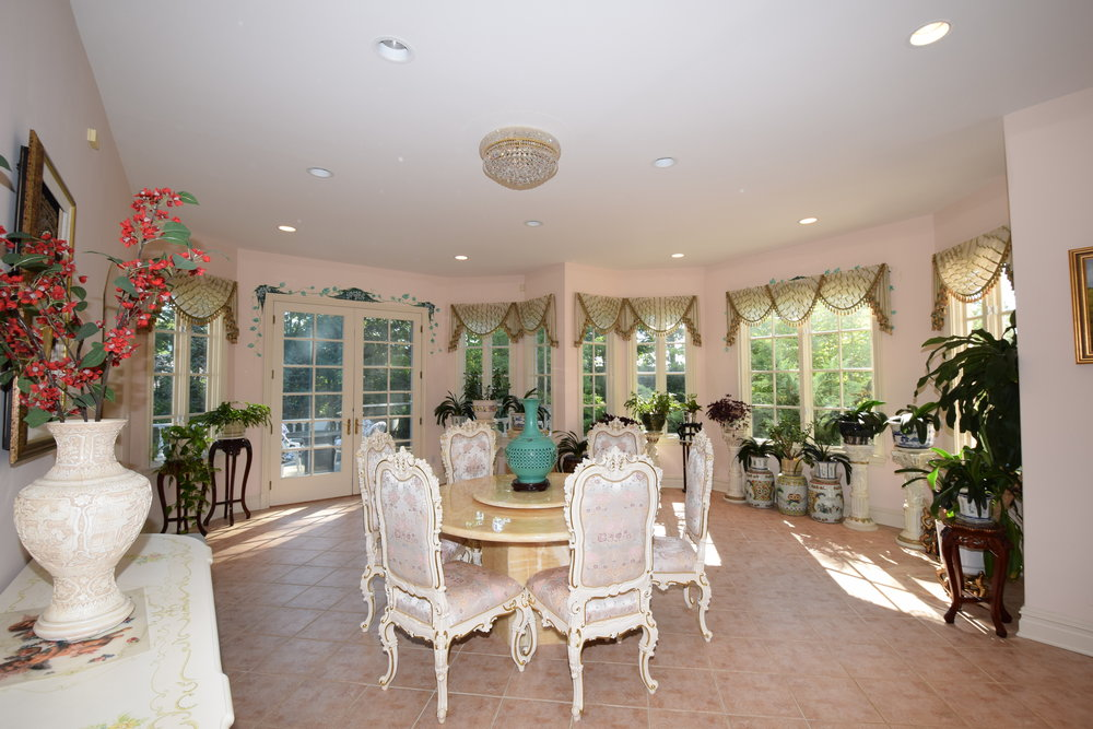 Conservatory with ample windows for added light, new French doors with entry to outdoor patio