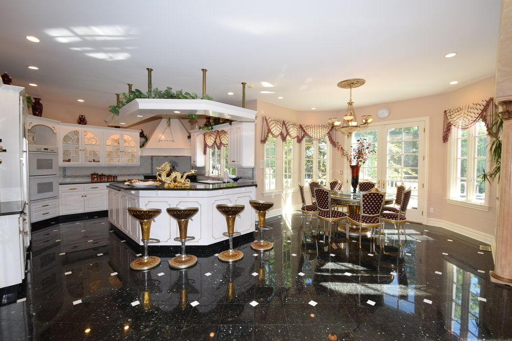 Spacious custom gourmet kitchen with center island, granite countertops