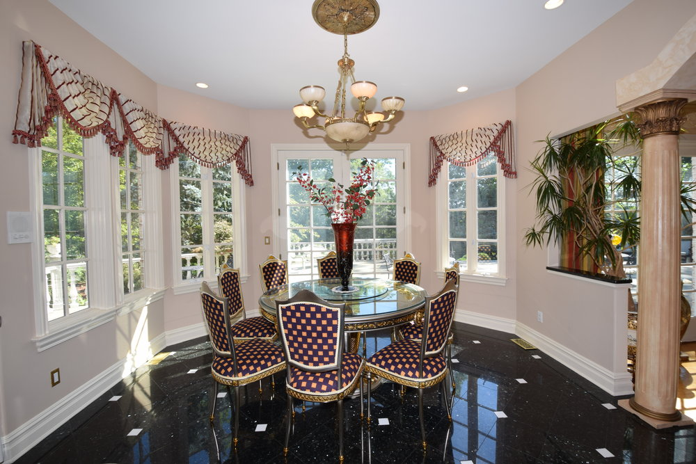 Breakfast Room overlooking patio and private secluded yard