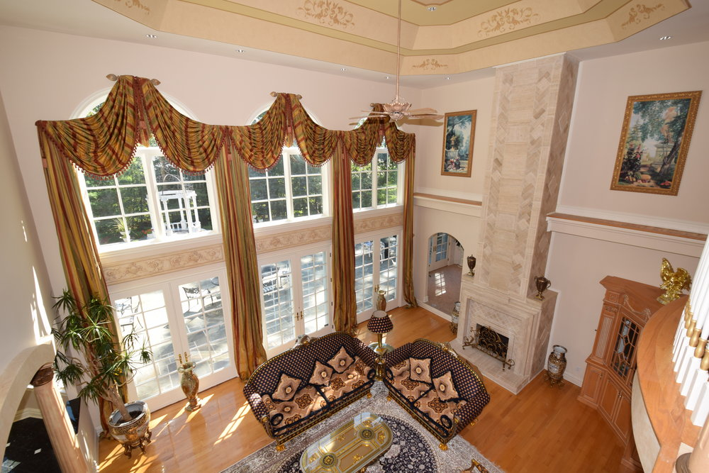 Great Room view from 2nd floor Gallery with 24ft high ceilings, 3 new French doors and large palladium windows