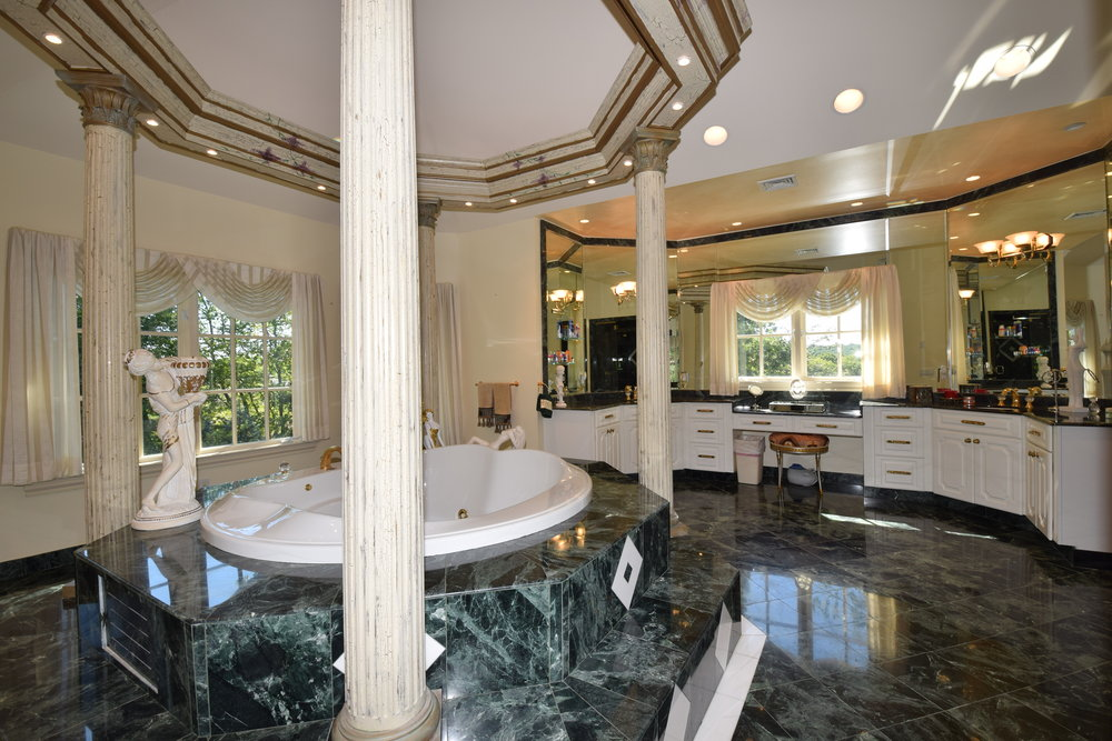 Large Master Bath with floor to ceiling marble shower, marble floors and marble countertops
