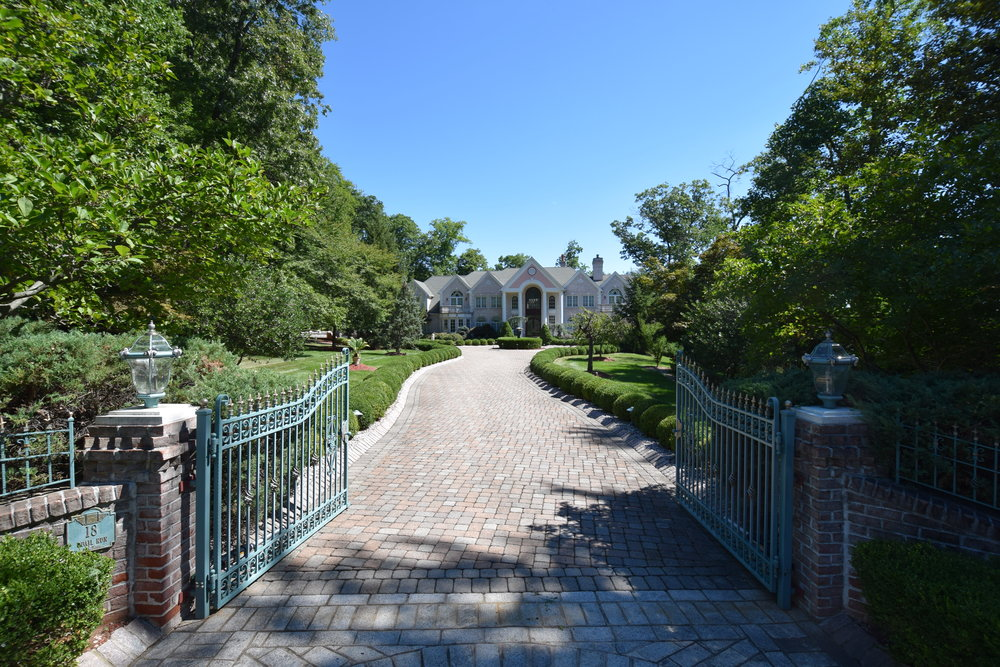Breathtaking gated entry with approx. 200 ft. paver driveway to front of home and Belgium block curbing