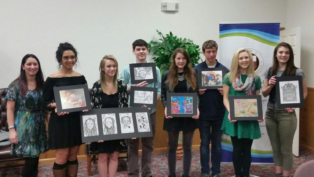 Pictured from left: Alysia Watt, art teacher; Makenzie Wilkinson; Candy Webb; Jordan Parnell, also holding Veronica Helsel's artwork; Cailin Brashear; Dillon Lance; Ally Bihary, and Alyssa Rosamilia. Not pictured, Veronica Helsel, art student; Alyssa Barilar, Arts committee chairwoman.