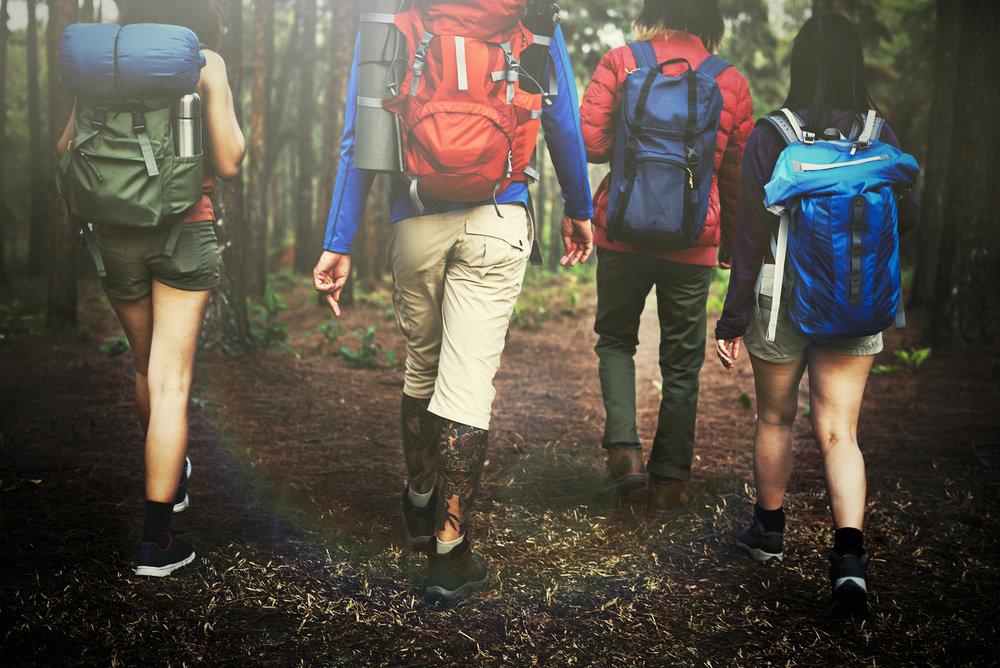 bigstock-Camping-Backpacker-Walking-Fri-132611771.jpg