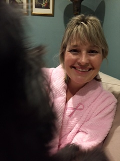 Comfy in my fluffy pink robe, photo bombed by my fluffy black dog Daisy.