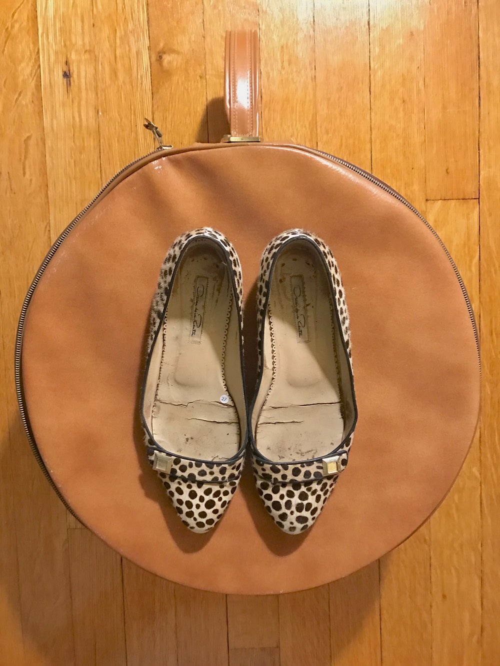 My oh-so-loved Oscar De La Renta flats + vintage round luggage.