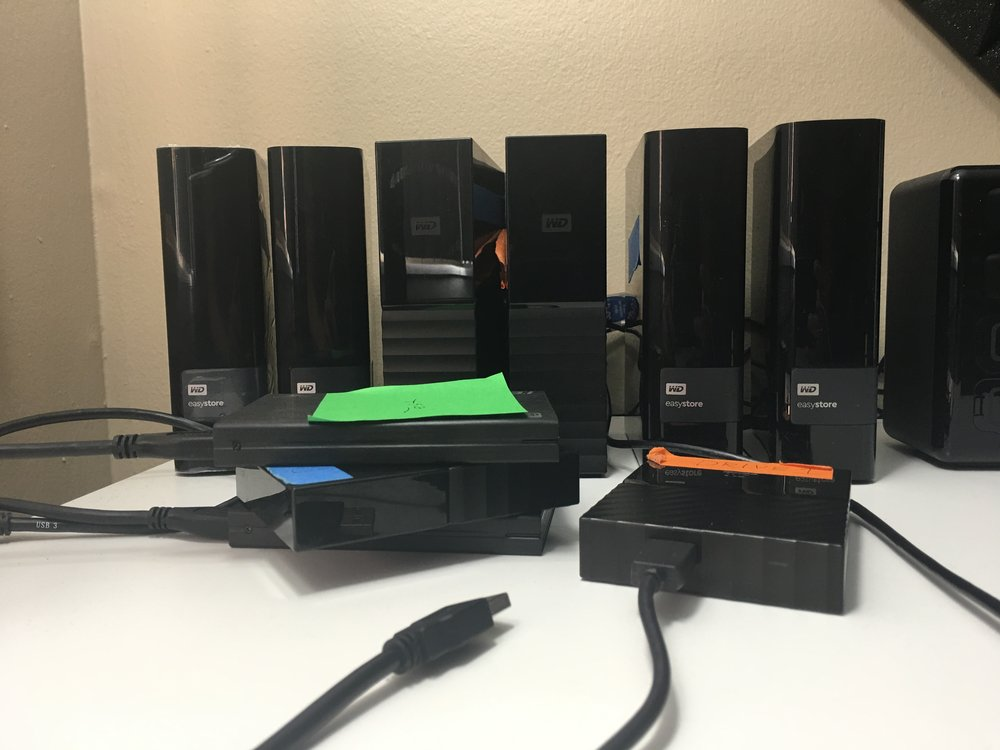 My current hard drive collection. 50TB+. Each second drive is a clone of the one next to it.
