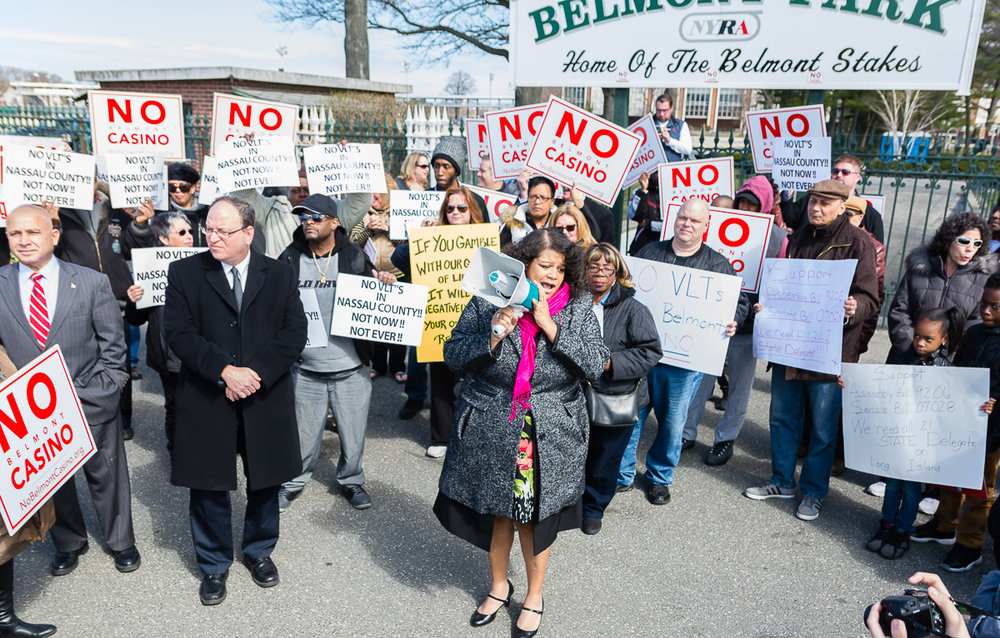 "New York State Assemblywoman Kimberly Jean-Pierre leads casino protesters in chants of ""Hell no, no casino,"" on March 26, 2016."