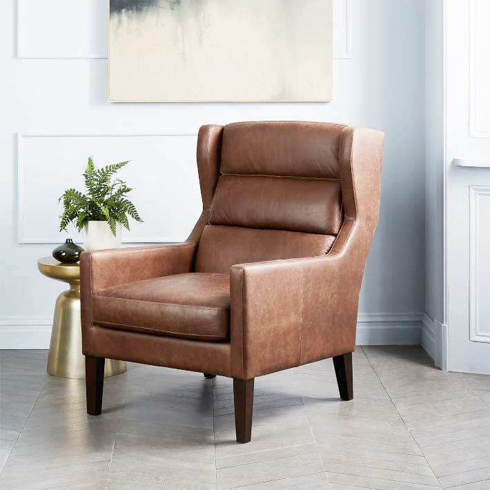 Clarke Leather Chair . Recalls the shape of Midcentury leather wing chairs at a fraction of the price. Add a vintage pillow to maximize the character. $1299.
