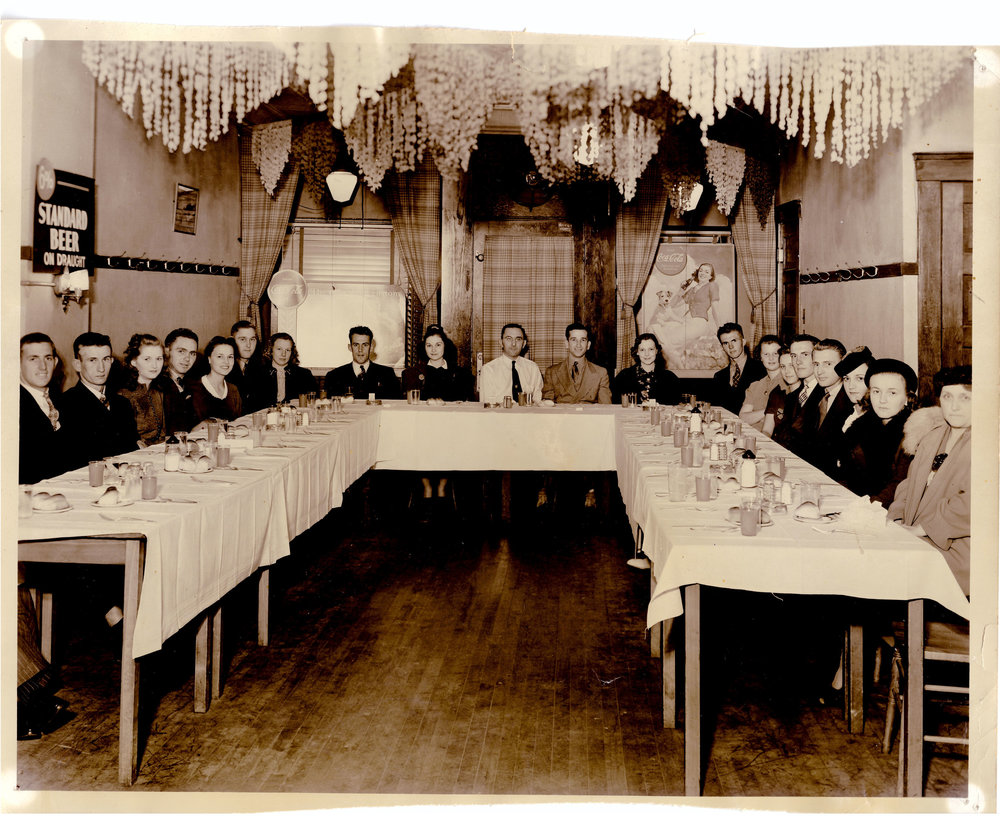 We've been hosting parties in the same room for over 80 years! - Henry Gunselman is in the white shirt and tie.