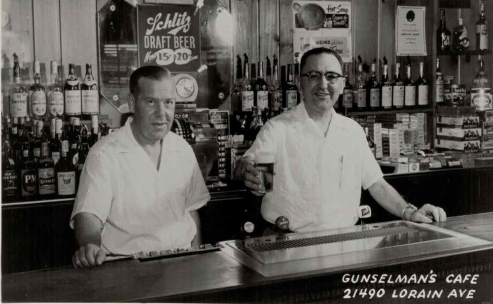 Russell S. Lovell (left) Henry J. Gunselman (right, giving the toast)