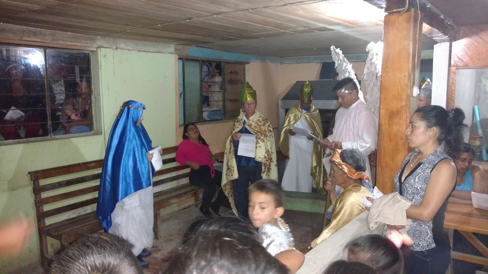 The Angel Gabriel (Giovanny) announces to Good News to Mary (Alva) that she will be the mother of Jesus. This is Alva's house, a restaurant her grandmother owns. She is 19 yrs old, and 7 months pregnant with her first child. She volunteered for the role in the Pase del Niño.