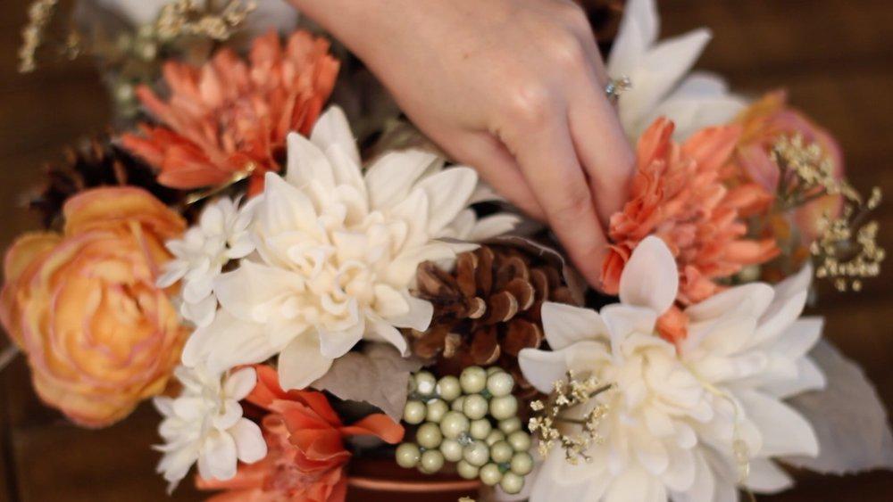 add pinecones and fairy lights.jpg