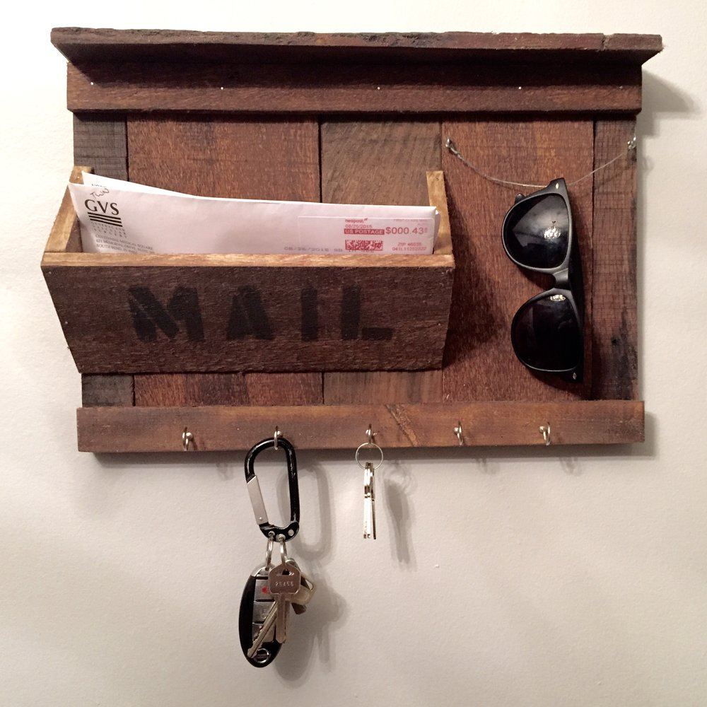 This was the first entryway organizer I ever made. It was a semi-original idea heavily inspired by designs I found on Pinterest. This is made entirely of pallet wood, it was not sanded, and colored using Minwax Early American. The word mail was spray painted on using black spray paint and stencil letters.