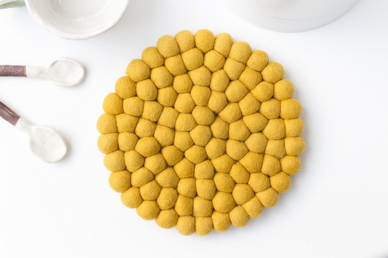 Mustard Pom Pom Trivet 20cm The Felting Dorcas