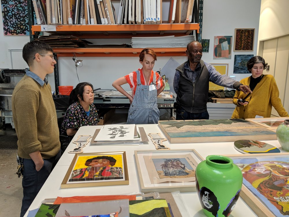 Image (left to right): ECF's Program Supervisor Eugenia Barbuc, artist Vickie Uyeda, The Main's director Allison Agsten, artist Milton Davis, and The Main's curatorial associate Monica Rodriguez looking at Milton's and Vickie's work at ECF