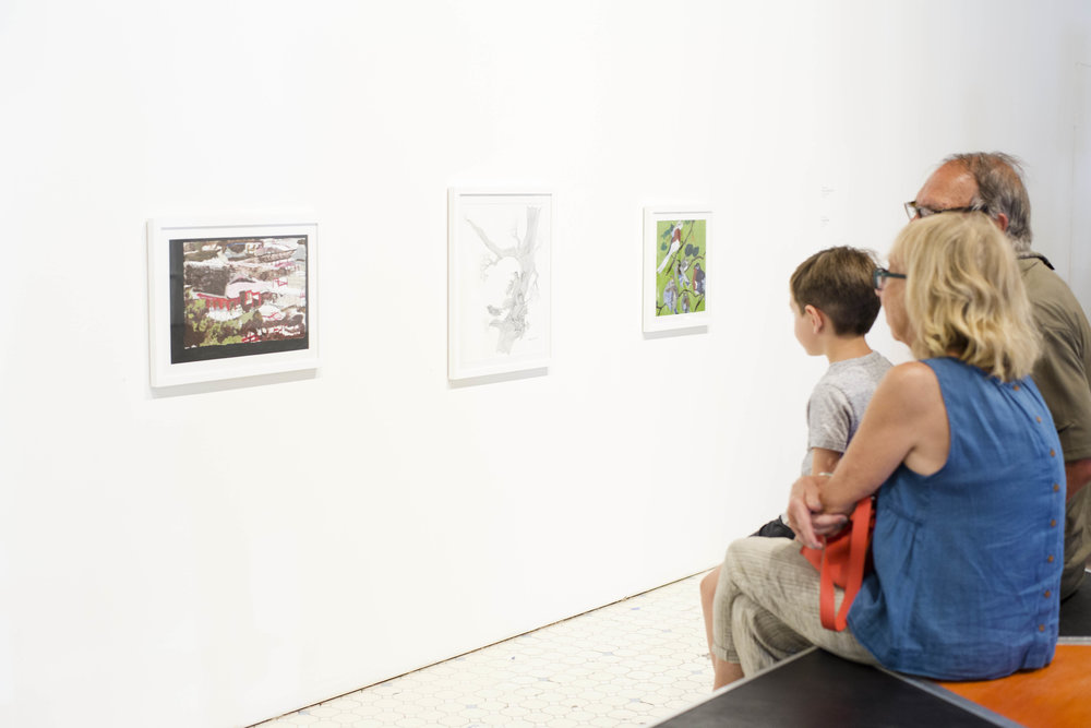 Visitors viewing work in the exhibition