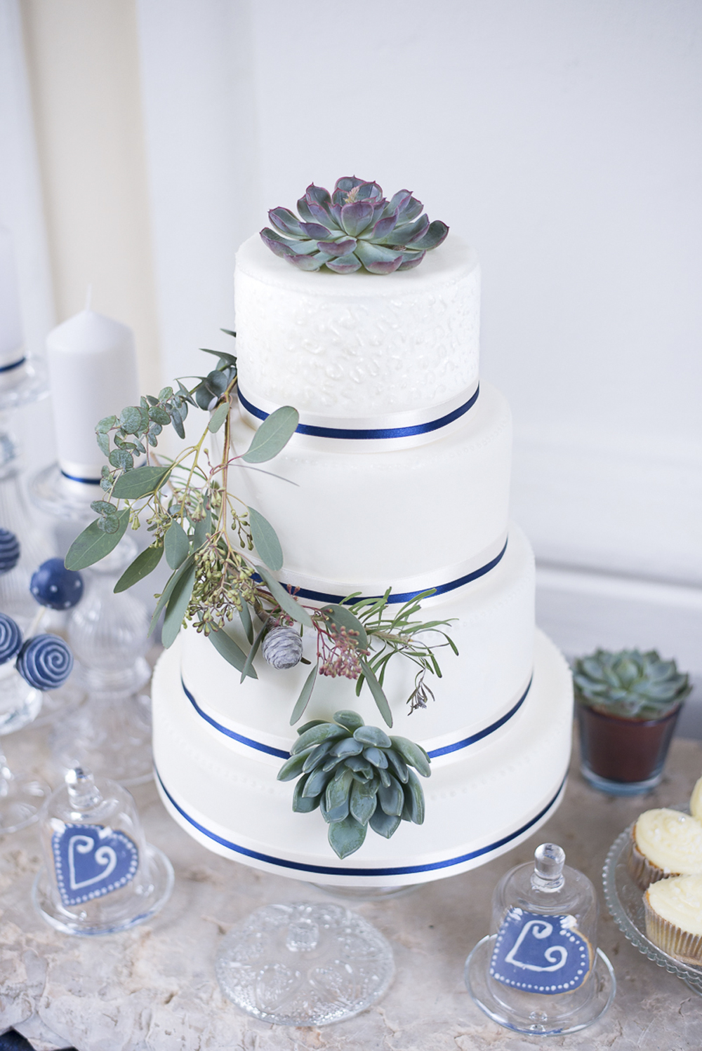 Wedding cake and sweet table inspiration in blue white and dusty green at Schloss Laudon Vienna Austria by Barbara Wenz Photography