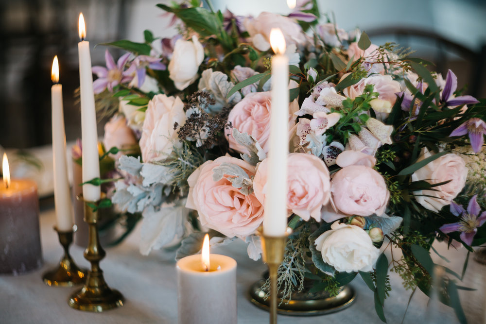 Blush roses violet clematis astilbe dahlias and Dusty Miller table centrepiece by PONK Rentals