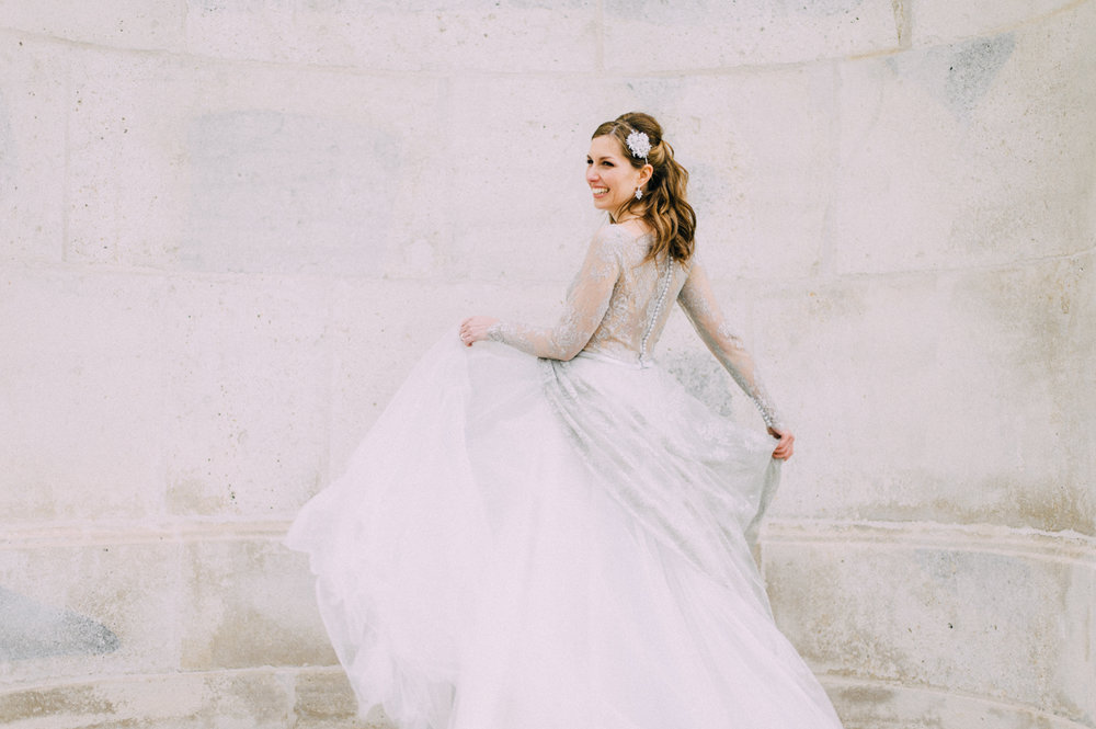 Bride in wedding dress Solaine Piccoli headpiece by Niely Hötsch at pre-wedding engagement shooting at Belvedere Palace Vienna Austria by international wedding photographer Claudia Magas Ladies & Lord