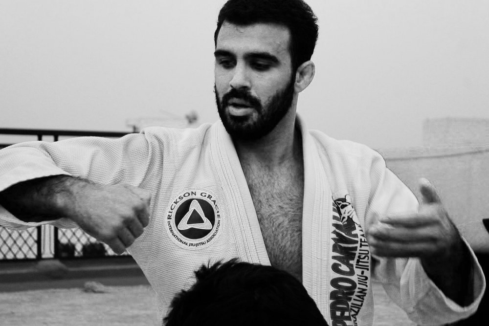 "Rodrigo Teixeira   Rodrigo Teixeira is Brazilian, born in Rio de Janeiro and has been practicing the art of Brazilian Jiujitsu and competing actively for the last 24 years. He now holds a 4th degree black belt in the art.  He lived for 15 years in California, where he opened his own academy in 2003. The ""Rodrigo Teixeira Brazilian Jiu-Jitsu"" has become a reference in the art on the outskirts of the Los Angeles County garnering a big number of students of different age groups.  Nowadays, Rodrigo is an Instructor at the Gentle Art Academy in Singapore, one of the best gyms in the Country. Besides classes, Rodrigo traveled to manny different countries participating in workshops and teaching Brazilian Jiu-Jitsu to many, including the military and the SWAT units of different police departments.  Meet Rodrigo here:  http://youtu.be/2_ZNAiQJqEs"