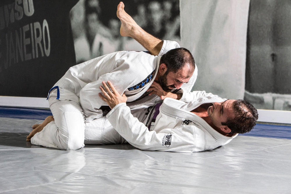 "Rafael Correa de Lima ""Gordinho"" - Legend in circle   Voted most technical fighter, Master Rafael is a integral part of the family of Jiu Jitsu in Brazil and in later years has significantly contributed to the growth of Jiu Jitsu in the United States. He is a World Champion and 7 x Brazilian National Champion."