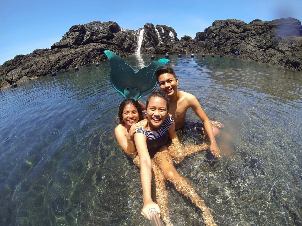 My siblings and I (with the fins) waiting for another wave to crash over us in Laswitan, a rock pool formation in Cortes, Surigao del Sur.