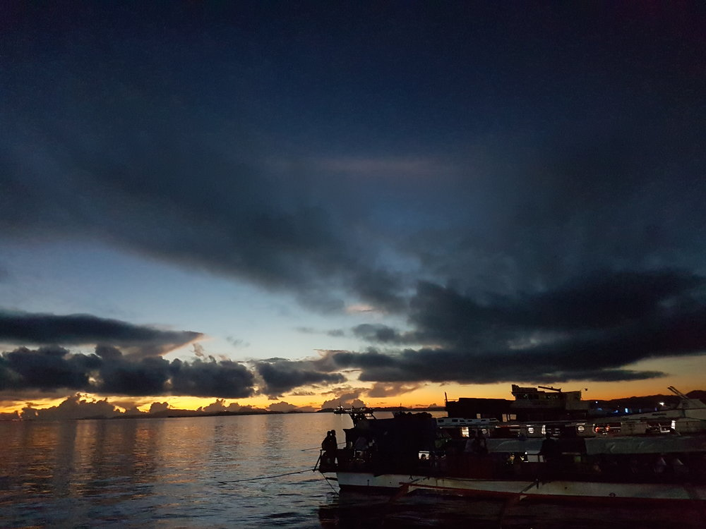 The 5:00am view of Surigao City's Boulevard taken from the big outrigger boat sailing for Siargao Island.