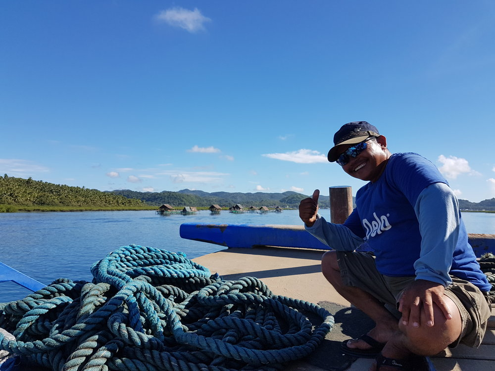 The friendliest crew member on the boat intentionally blocking my photo of Dapa Port and the fish cages around the Dapa Channel. Boatmen like him make a living ferrying people and cargo from Surigao to Siargao Island daily.