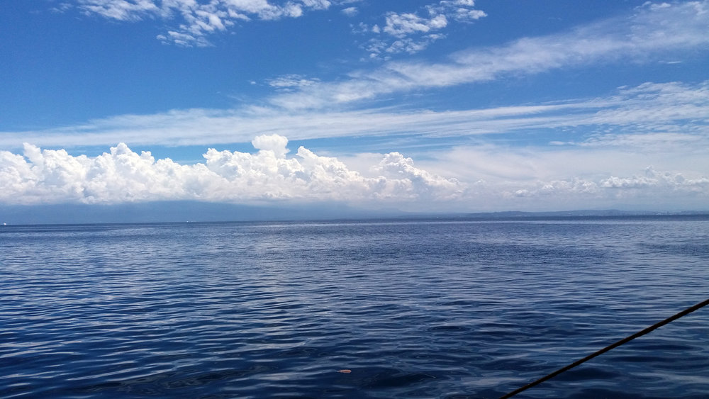 From the boat, anchored north of Talicud Island, one sees the vast expanse of Davao Gulf's waters where underneath lies Mansud Wall.