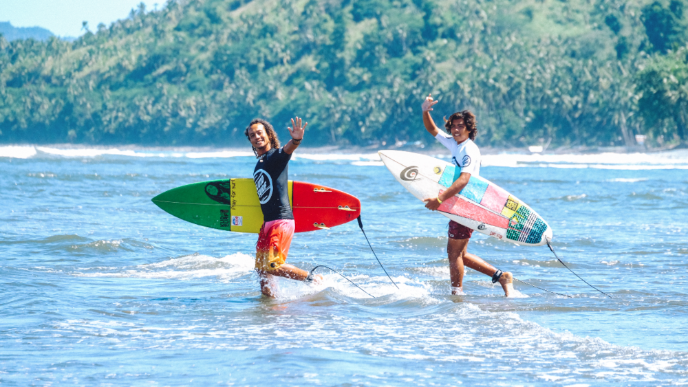 Surfers Ongster Montenegro and Wawa Delamide before heading out for a heat in Lanuza. Photo by Michael Eijansantos.