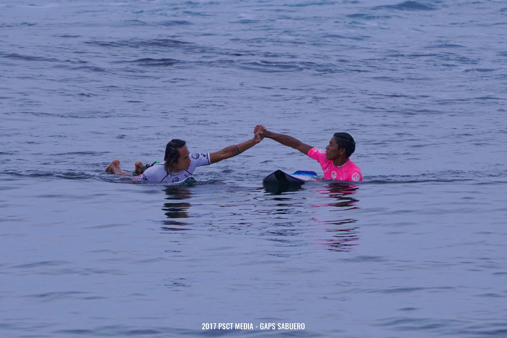 After the end of the competition, Siargao's top surfers Philmar Alipayo and Piso Alcala share a moment before paddling back to the tower. Photo by Gaps Sabuero.