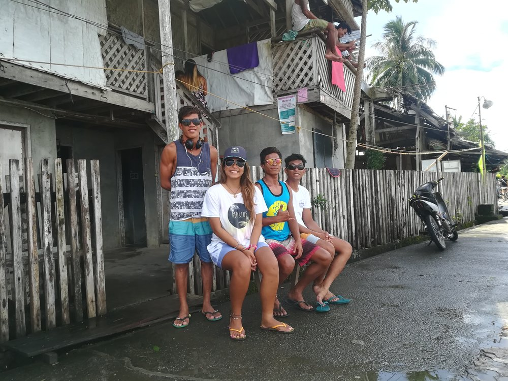 "L-R: Dahican local and professional skimboarder Sonny Boy "" Bayogyog "" Aporbo, this mermaid, Lanuza locals Soysoy and Olin."