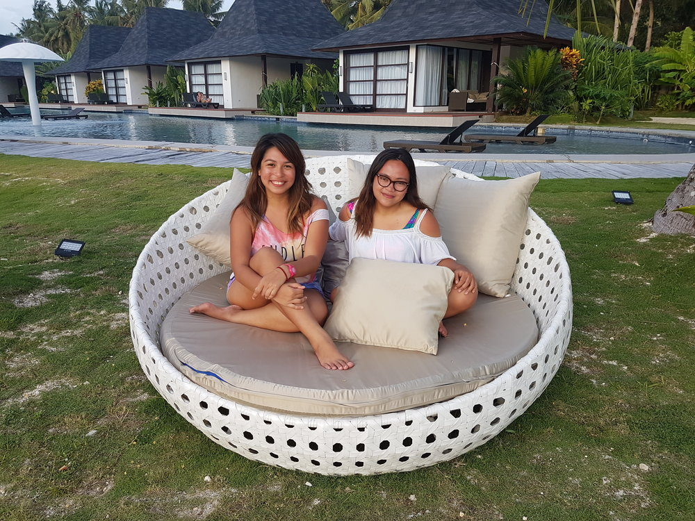 Alternatively, enjoy the Siargao view with your travel buddy. Here's Sandra and me from a photo circa 2016 (my first time in Siargao).