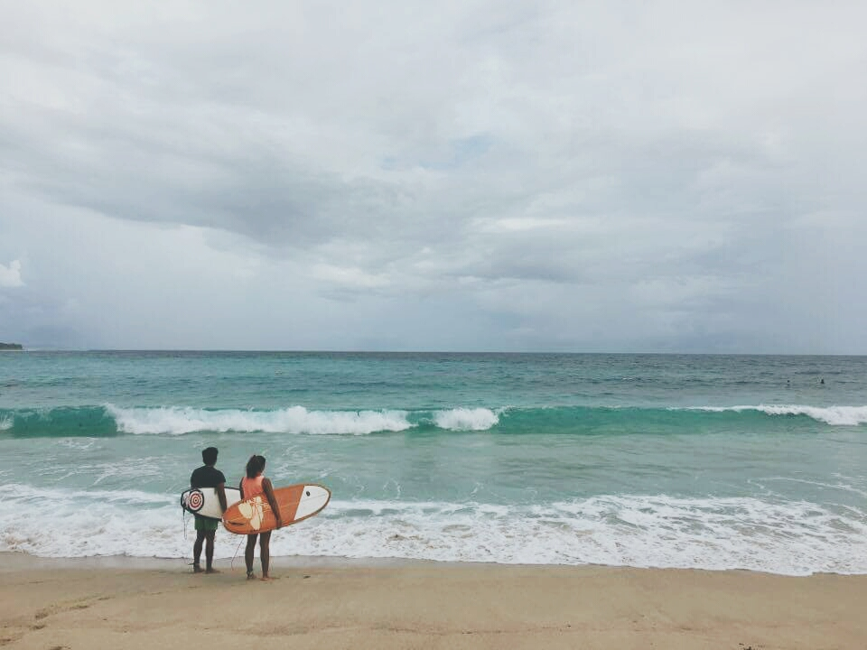 Surfing in Dahican | Millennial Mermaid