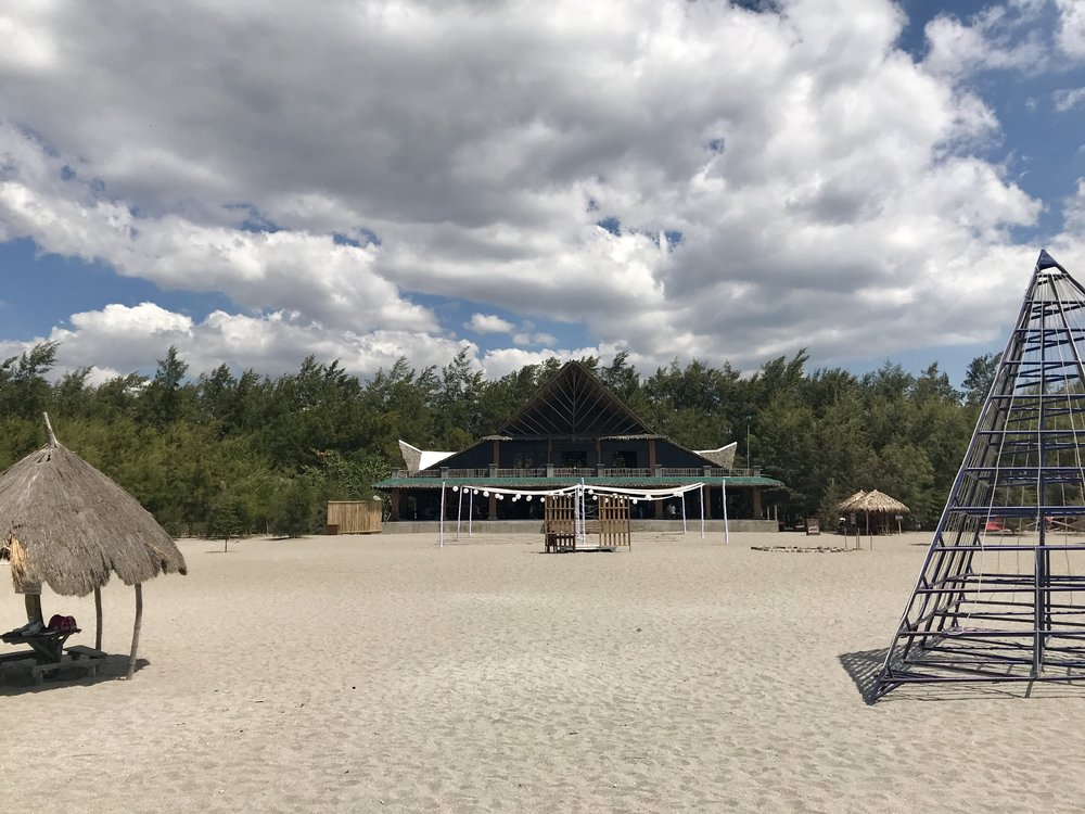 Domingo's Restaurant and pavilion and the huts scattered on the shore.