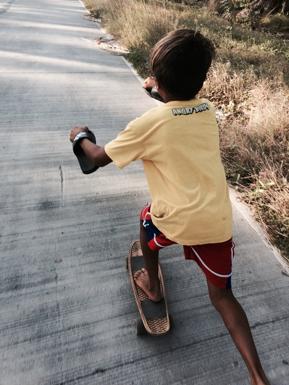 Kids have it so easy. Start them young and they'll learn every trick there is before I could even learn to slide. Photo by Cheen.