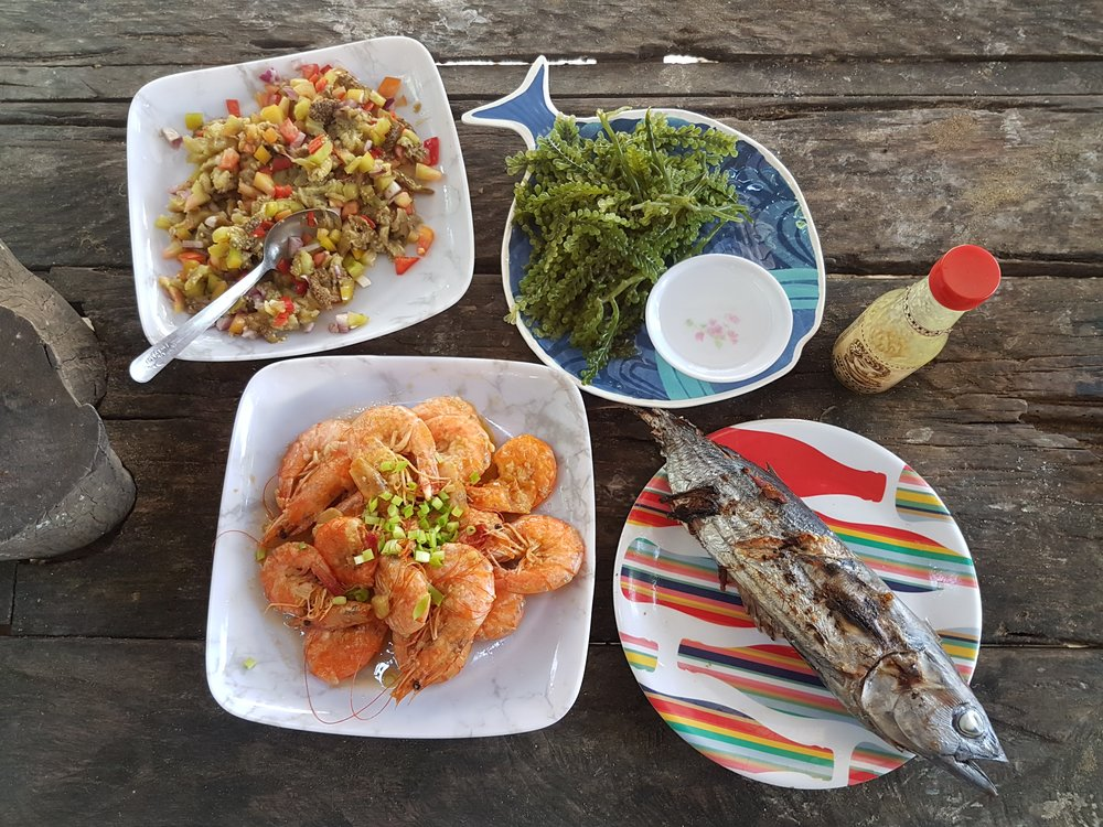 An island feast that costs around PHP 500 for five hungry, stoked adults—only in Palawan!