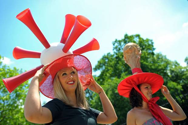Racegoers pose for photographers with their World Cup themed hats.jpeg