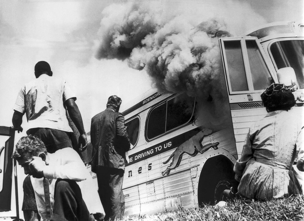Anniston, Alabama 1961. Freedom Riders bus is bombed by anti-civil rights protesters.