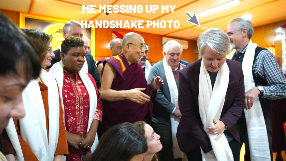 """This is a classic """"Jones"""" move. Everyone else got a photo shaking hands with the Dalai Lama. I was messing with my Welcome scarf when the shutter clicked."""