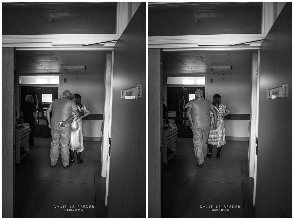 Couple stood in hospital corridoor, about to head to theatre for the delivery of their twins.