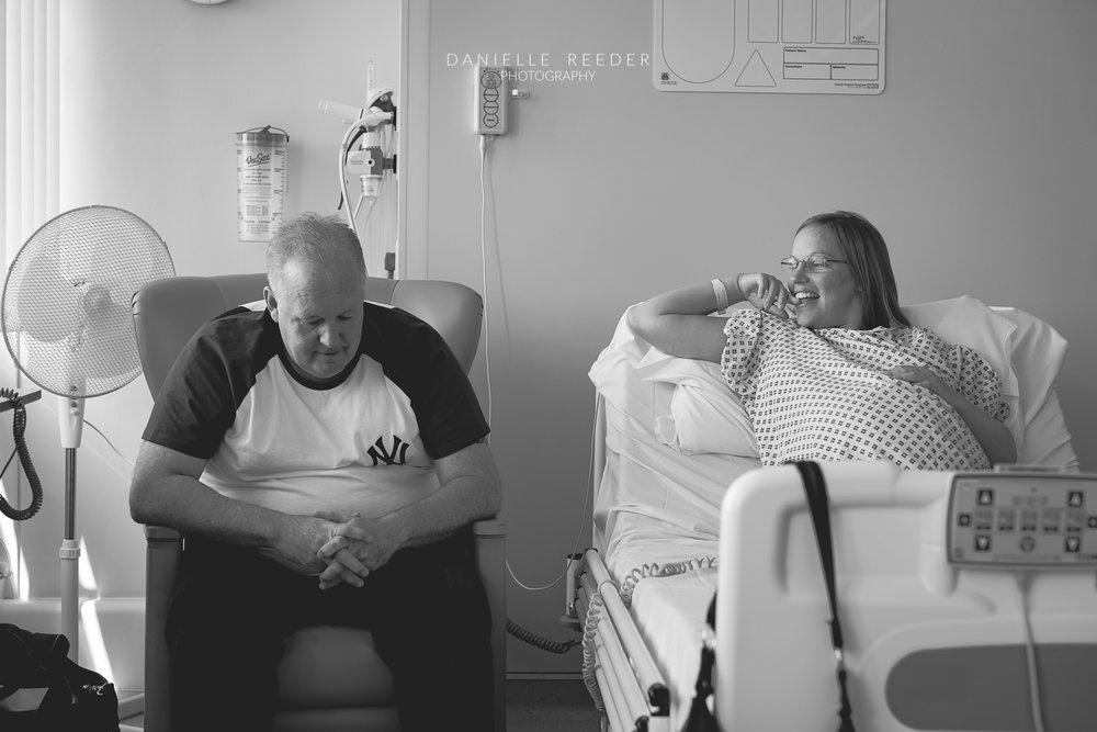 Husband and wife chatting whilst waiting to go to theatre for cesarean section.