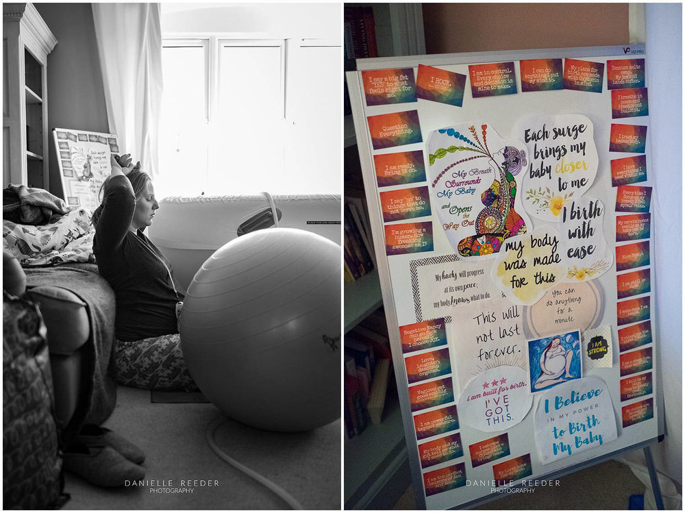 Labouring mama sat against the sofa with her affirmation board in the background.