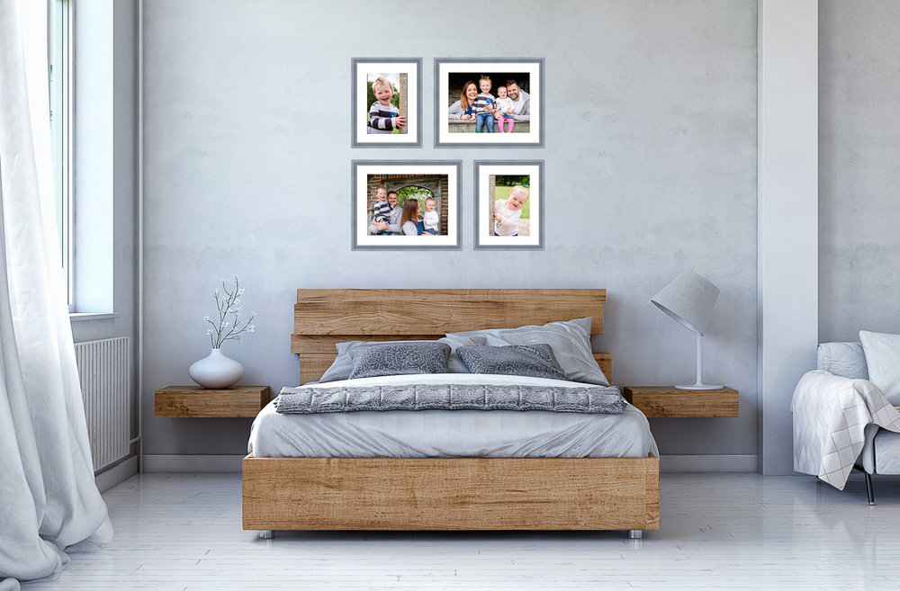 Bedroom with picture frame gallery above the bed, consisting of two landscape and two portrait images of a family.