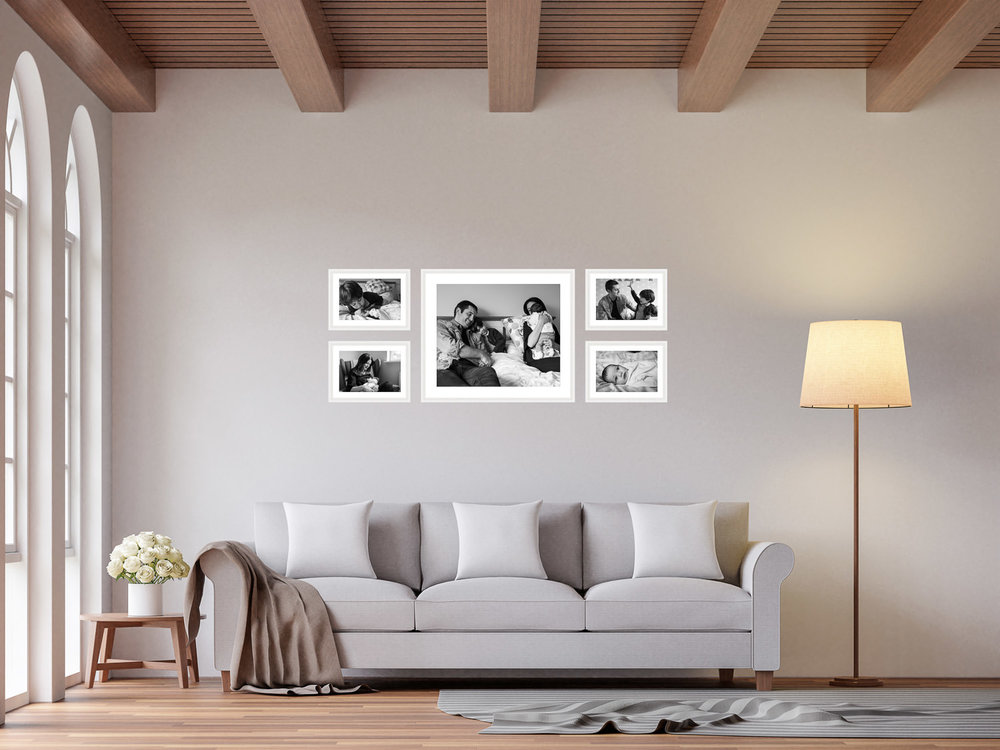 Scandinavian living room with picture frame gallery above the sofa, consisting of five landscape images.