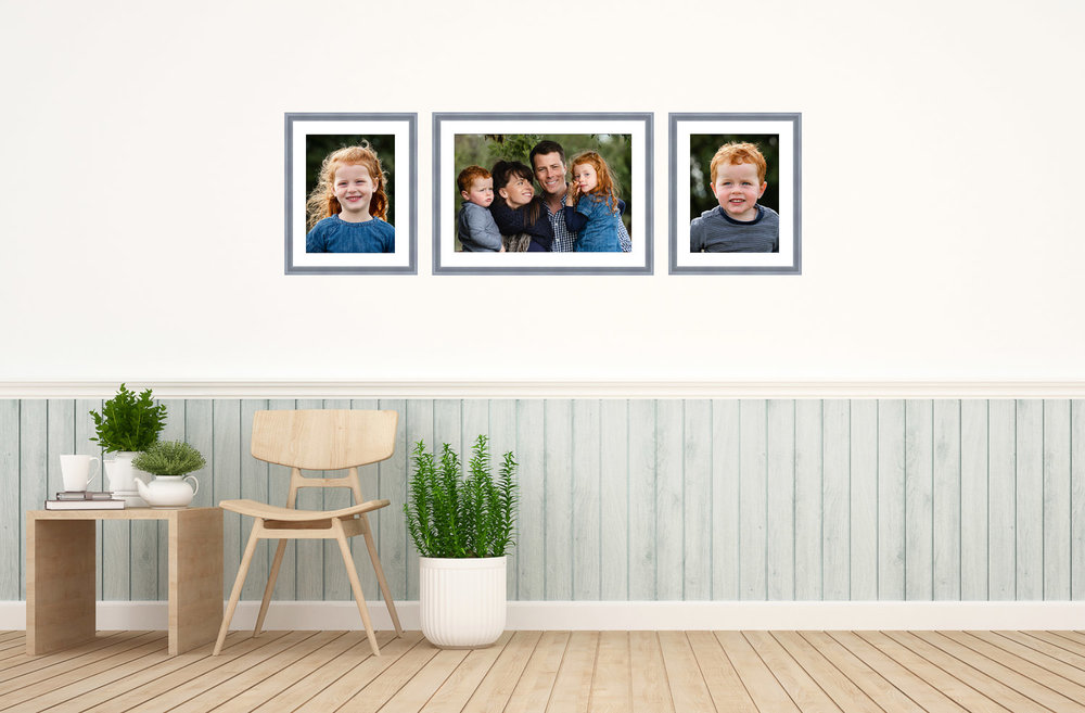 Hallway with gallery wall consisting of one landscape and two portrait images of a family.