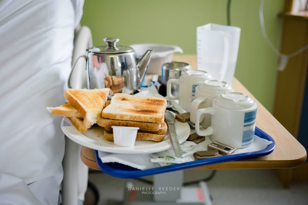 Hospital tray full of of tea and toast.