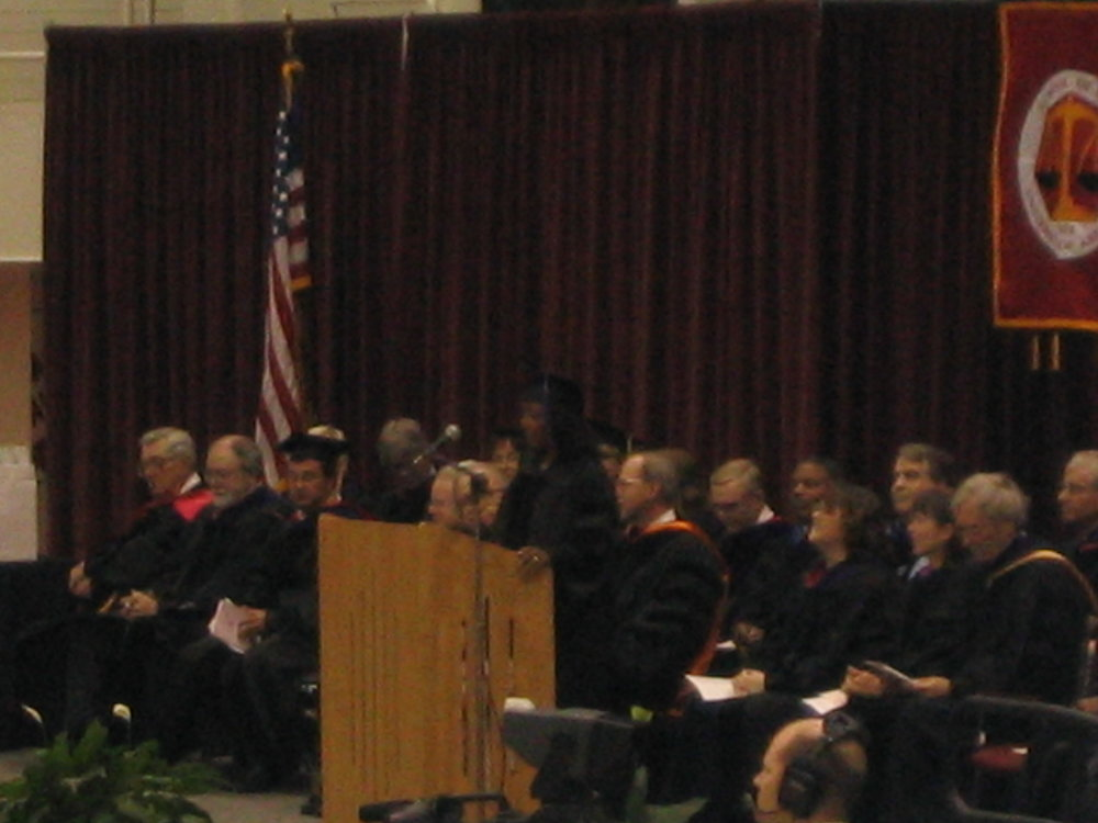 Blurry photo of me speaking at my law school graduation.